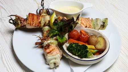 Barbecued shrimp, salmon and calamaris on the spit with pot fried vegetables and Dionysos sauce.