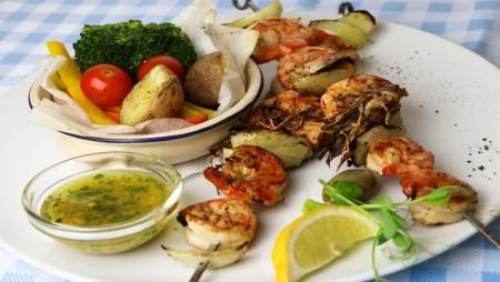 Shrimp on the spit with pot fried vegetables and garlicky olive oil.